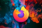 Mozilla Firefox browser logo against a background of abstract blue and orange smoke.