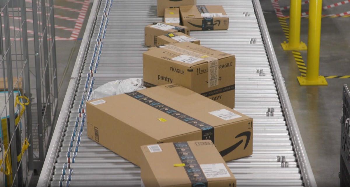 amazon packages on conveyor belt