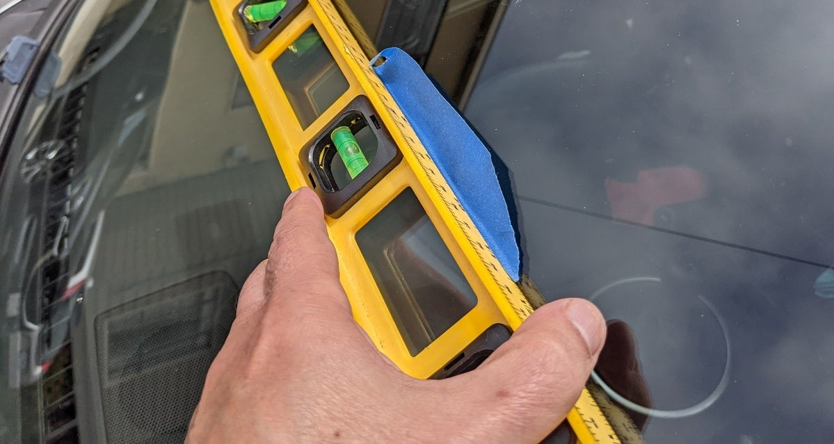 tape on level how to install a dash cam