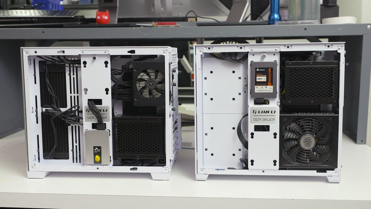 o11 air mini next to o11d mini on a table with PSU/storage chamber showing